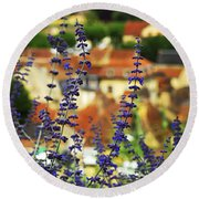 Blue Flowers And Rooftops In Sarlat Round Beach Towel