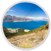 Blue Surface Of Lake Hawea In Central Otago In New Zealand Round Beach Towel