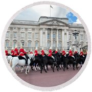 British Royal Guards Perform The Changing Of The Guard In Buckingham Palace Round Beach Towel