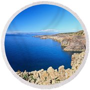 cliff in San Pietro Island Round Beach Towel