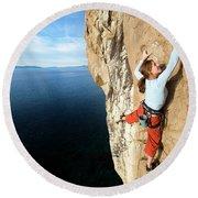 Climber Grabs A Hold While Climbing Round Beach Towel