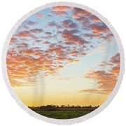 Clouds Over Landscape At Sunset Round Beach Towel