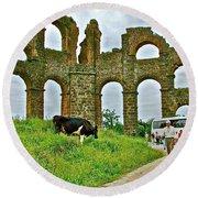 Cow By Second Century Aspendos Aqueduct-turkey Round Beach Towel