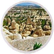 Dog Looking At Fairy Chimneys In Cappadocia-turkey Round Beach Towel