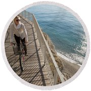 Elevated Perspective Of Woman Riding Round Beach Towel