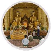 faithful Buddhists praying at Buddha Statues in SHWEDAGON PAGODA Round Beach Towel