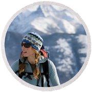 Female Backcountry Skier Skinning Round Beach Towel