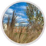 Founders Hall Through The Grasses Round Beach Towel