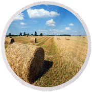 Haystacks In The Field Round Beach Towel