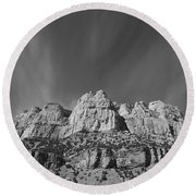 Mountain Peaks And Shimmering Sky Round Beach Towel