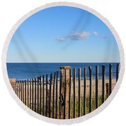 New England Beach Past A Fence Round Beach Towel