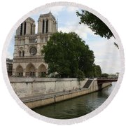 Notre Dame Along The Seine Round Beach Towel