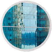 Reflections In Modern Glass-walled Building Facade Round Beach Towel