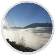 Sea Of Fog With Sunbeam Round Beach Towel