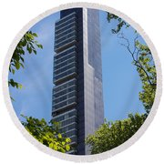 Skyscraper Rising Among Trees Of Madison Square Park Round Beach Towel