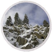 Snow Covered Cliffs And Trees Round Beach Towel