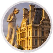 Statue Below Musee Du Louvre Round Beach Towel