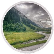 storm clouds over mountains of ladakh Jammu and Kashmir India Round Beach Towel