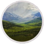Storm Clouds Over The Klondike Valley Round Beach Towel