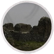 The Battered Remains Of The Urquhart Castle In Scotland Round Beach Towel
