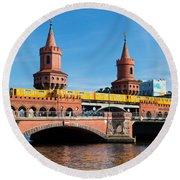 The Oberbaum Bridge In Berlin Germany Round Beach Towel