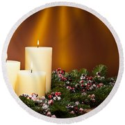 Three Candles In An Advent Flower Arrangement Round Beach Towel