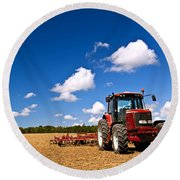 Tractor In Plowed Field Round Beach Towel