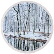 Tree Line Reflections In Lake During Winter Snow Storm Round Beach Towel