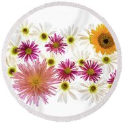 Variety Of Flowers Against White Round Beach Towel