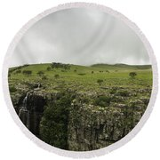 Waterfall Flowing Over The Edge Round Beach Towel