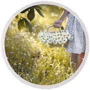 Woman Picking Flowers In A Wild Flower Meadow Round Beach Towel