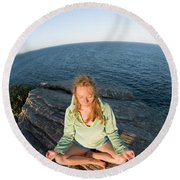 Yoga On Rocky Outcrop Above Ocean Round Beach Towel