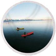 A Photographer Photographs A Kayaker Round Beach Towel