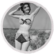1950s Smiling Young Woman Kneeling Round Beach Towel