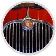 1958 Jaguar Xk150 Roadster Grille Emblem Round Beach Towel by Jill Reger
