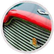 1960 Aston Martin Db4 Gt Coupe' Grille Emblem Round Beach Towel by Jill Reger