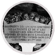 A Marker With Skulls And Bones In The Catacombs Of Paris France Round Beach Towel