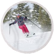A Skier Descends A Snowy Slope Round Beach Towel