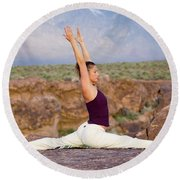 A Woman Practicing Yoga On A Dry Lake Round Beach Towel