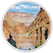 A Woman Sits By The Colorado River Round Beach Towel