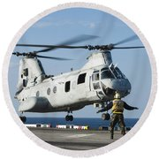 An Aviation Boatswains Mate Directs Round Beach Towel