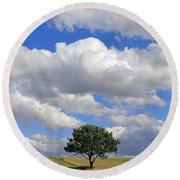 Dramatic Clouds And The Tree Round Beach Towel