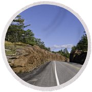 Driving Through A Rock Cut Round Beach Towel