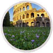 Flowers At The Coliseum Round Beach Towel