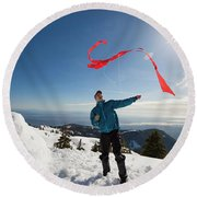 Flying A Kite On A Snowy Mountain Round Beach Towel