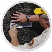 Man Getting A Rubbing Of Fallen Soldier's Name At The Vietnam War Memorial Round Beach Towel