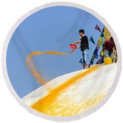 Man Throwing Orange Paint On Boudhanath Stupa Round Beach Towel