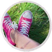 Pink Sneakers On Girl Legs On Grass Round Beach Towel