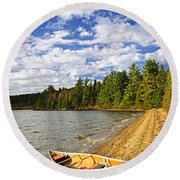Red Canoe On Lake Shore Round Beach Towel by Elena Elisseeva