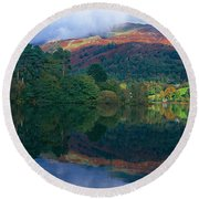 Reflection Of Hills In A Lake Round Beach Towel